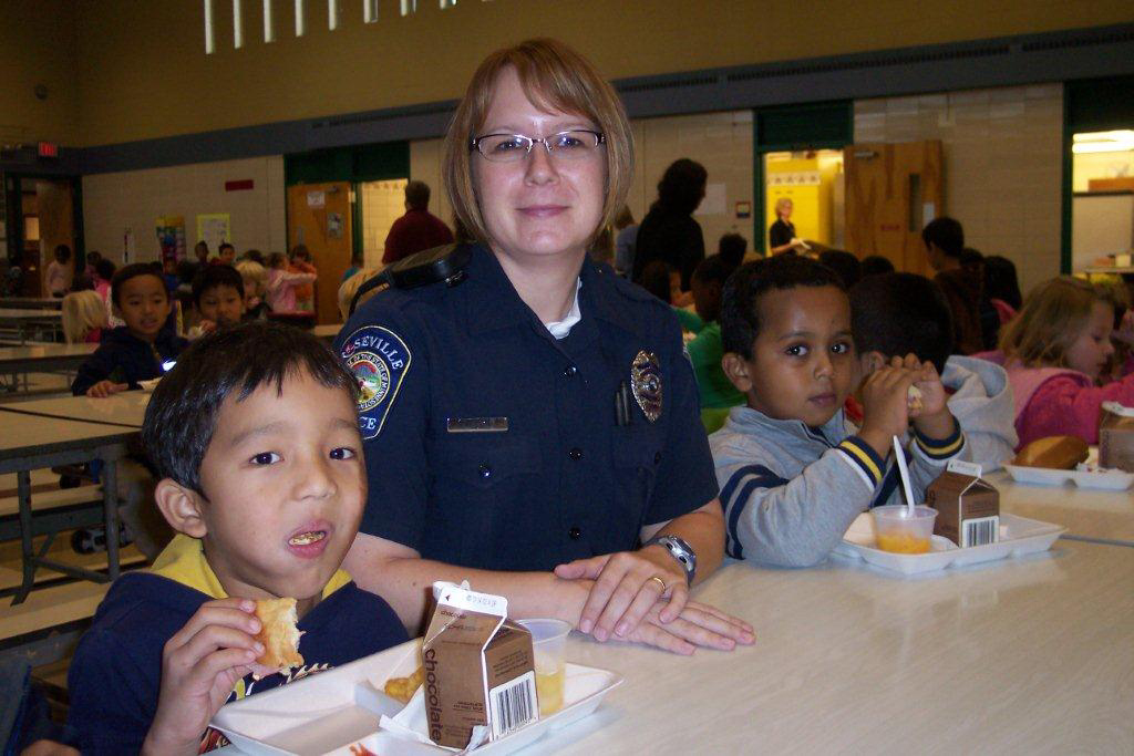 Students enjoying lunch with Officer Baker